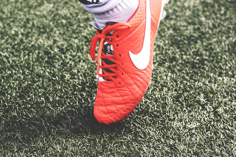 sports physical - a soccer cleat on turf