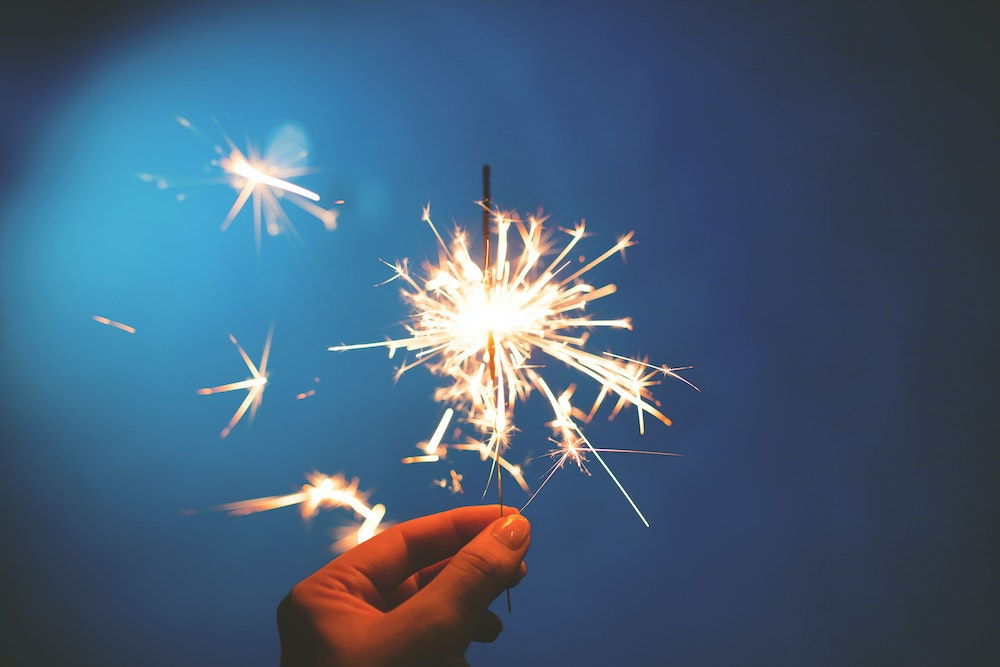 fire safety - person holding a sparkler